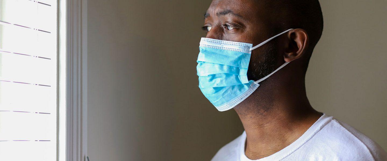 black man wearing mask